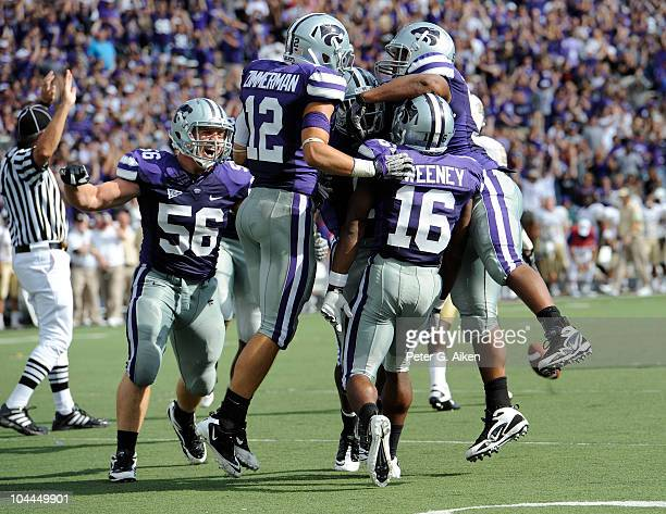 The Kansas State Wildcats celebrate after defensive back Terrance Sweeney intercepted a pass on the final play of the game against the Central...