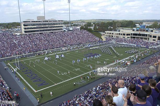 The Kansas State Wildcats run onto the field before their game with the Kansas Jayhawks, during a NCAA football game on October 06, 2007 at Bill...