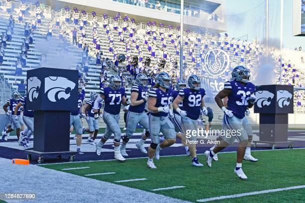 The Kansas State Wildcats run onto the field prior to a game against the Oklahoma State Cowboys at Bill Snyder Family Football Stadium on November 7,...