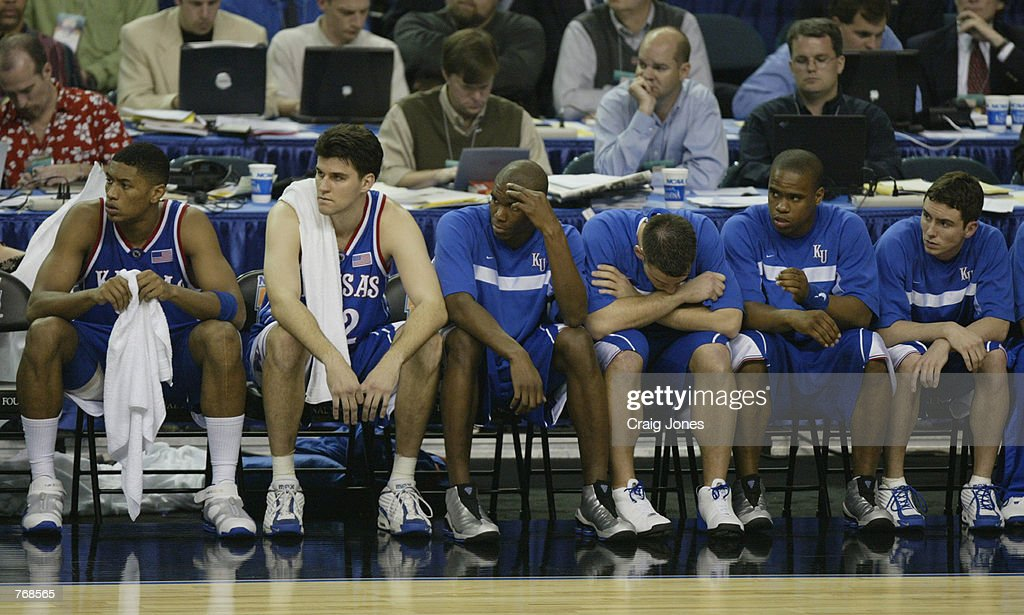 The Kansas University Jayhawks Bench Sits Dejected During Semifinal Round Of NCAA Mens Final