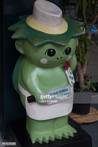 The Kappa Kawataro is a water spirit of Japan with webbed hands and feet and a tortoise shell Crowning their head of pageboy style hair is a circular...