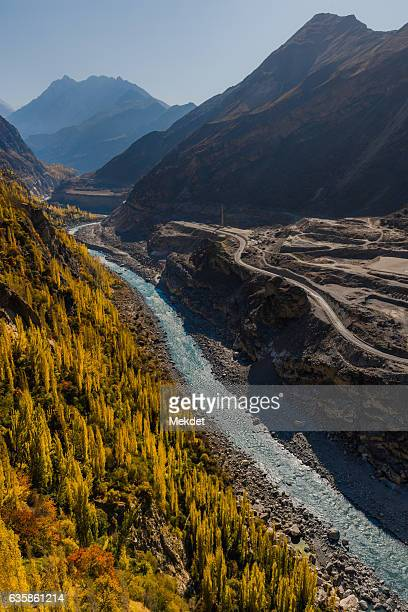 The Karakoram Highway along with the Hunza River in Autumn