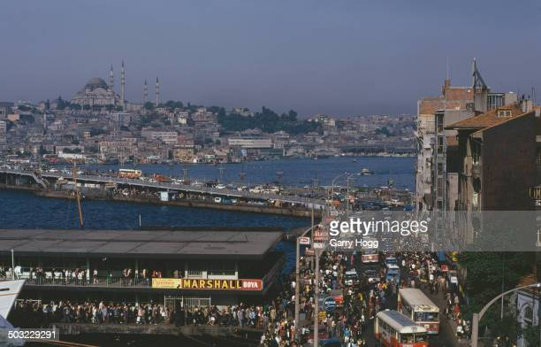The Karaköy neighbourhood of Istanbul in Turkey with the Galata Bridge stretching across the Golden Horn 1973 The Süleymaniye Mosque is visible in...