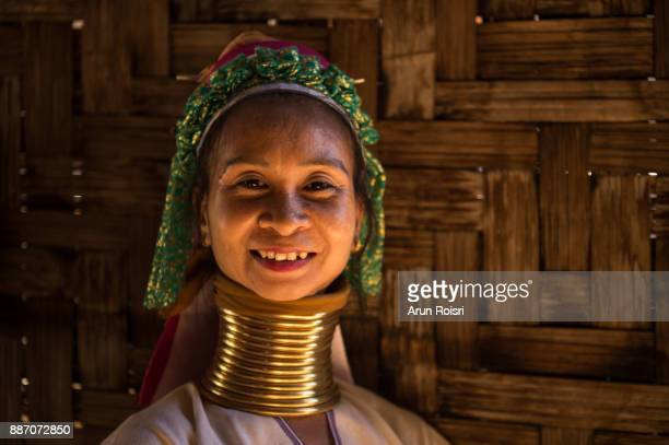 The Karen are a tribal group who have historically lived in the hills on the Myanmar (formerly Burma) side of the Thai border. Best recognized for their elongated necks, the Karen women wear heavy brass rings around their necks, forearms, and shins.