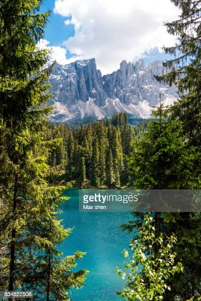 the karersee (carezza) lake in the dolomites, italy. - dolomiti foto e immagini stock