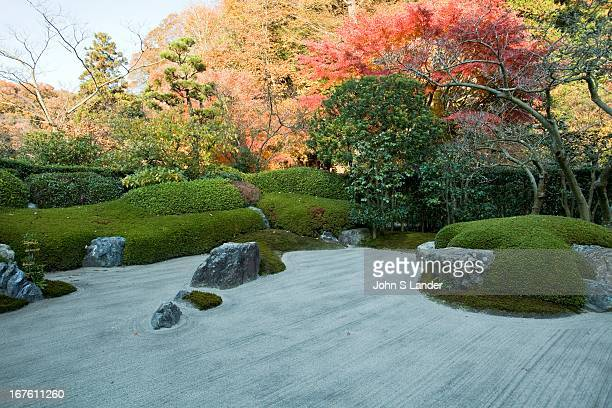 The Karesansui a Zen garden of raked sand rocks and plants representing legendary Buddhist Mount Shumi at Meigetsuin Temple Garden According to...