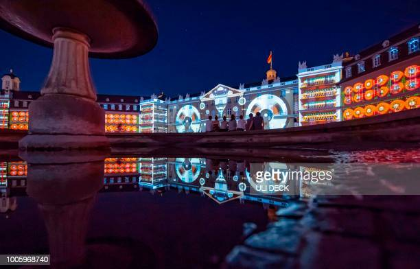 The Karlsruhe Palace is illuminated during a rehearsal of the show 'The Object of The Mind' created by the Global Illumination collective of visual...