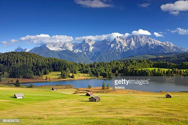 The Karwendel Mountain Range and huts along lake Gerold / Geroldsee near Mittenwald, Upper Bavaria, Germany.