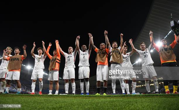 The Kashima Antlers celebrate following their sides victory in the FIFA Club World Cup UAE 2018 Second round match between Kashima Antlers and CD...