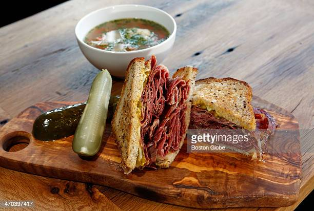 The Katz a pastrami sandwich with Mama Lils pickle mustard sweet cheese on rye is photographed next to a bowl of matzo ball soup at Moody's Deli in...