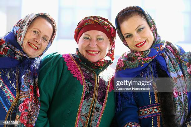 The 'Kazak Singers' dressed in their traditional Russian outfit smile at Rosa Khutor Mountain Cluster village on day five of the Sochi 2014 Winter...
