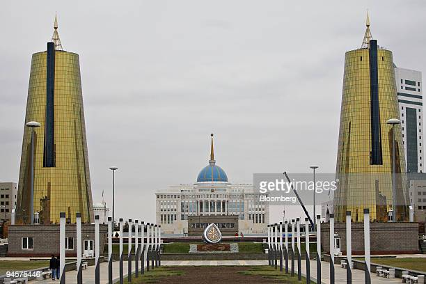 The Kazakhstan presidential palace stands flanked by Kzzyna a stateheld group of development funds right and a second currently unoccupied tower in...