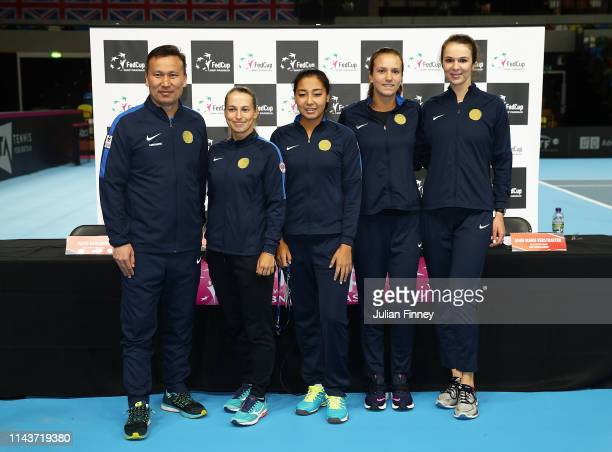 The Kazakhstan team line up Dias Doskarayev, Yulia Putintseva, Zarina Diyas, Anna Danilina, Galina Voskoboeva prior to the Fed Cup World Group II...