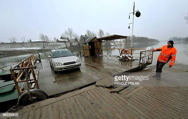 The keeper of the smallest Croatian public river ferry line pulls his ferry-boat to the frozen Kupa river, some 60 kilometers south of capital Zagreb...
