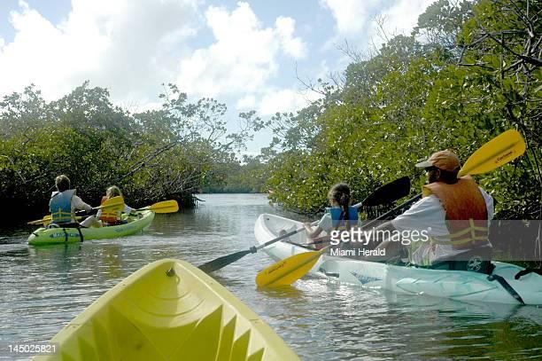 The Keller family of Washington DC explores the mangrove creeks at John Pennekamp Coral Reef State Park in Key Largo Florida