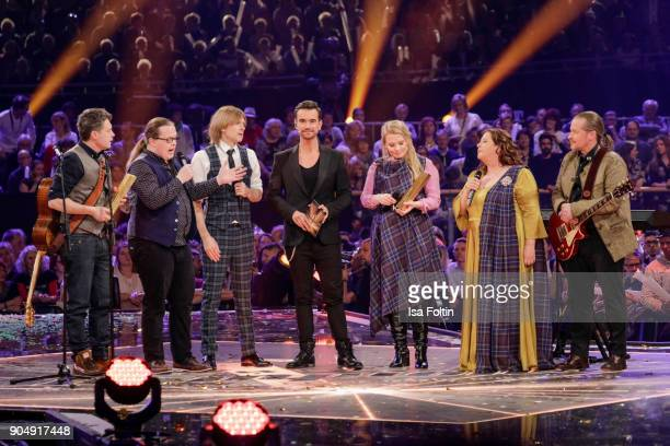 The Kelly family and German singer and presenter Florian Silbereisen during the 'Schlagerchampions Das grosse Fest der Besten' TV Show at Velodrom on...