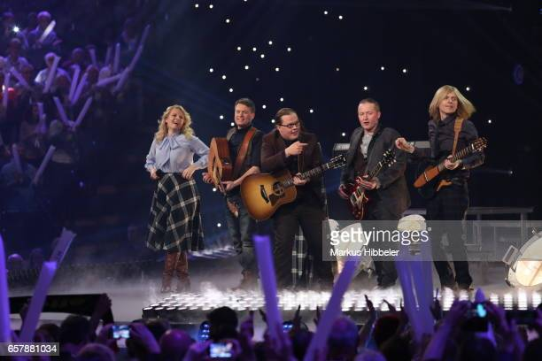 The Kelly Family performs during the show 'Schlagercountdown Das grosse Premierenfest' at EWE Arena on March 25 2017 in Oldenburg Germany