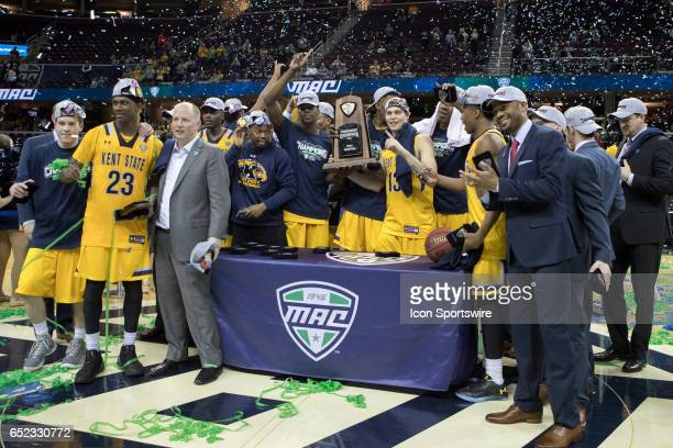 The Kent State Golden Flashes celebrate following the MAC mens basketball tournament championship game between the Kent State Golden Flashes and...