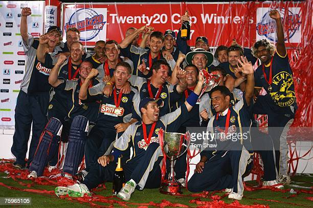 The Kent team celebrate with the trophy during the Twenty20 Cup Final match between Gloucestershire Gladiators and Kent Spitfires at Edgbaston on...