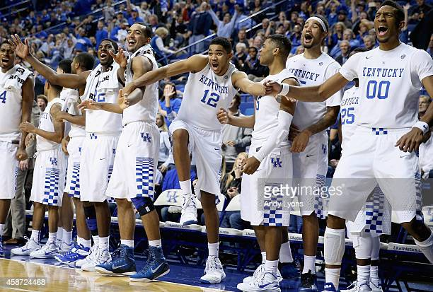 The Kentucky Wildcats bench celebrates during the game against the Georgetown College Tigers at Rupp Arena on November 9 2014 in Lexington Kentucky