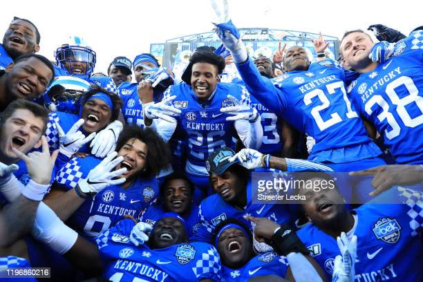 The Kentucky Wildcats celebrate after defeating the Virginia Tech Hokies 3730 in the Belk Bowl at Bank of America Stadium on December 31 2019 in...