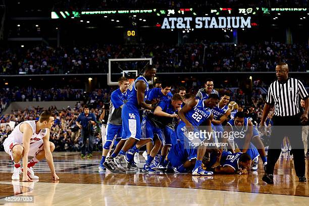 The Kentucky Wildcats celebrate after defeating the Wisconsin Badgers 7473 in the NCAA Men's Final Four Semifinal at ATT Stadium on April 5 2014 in...