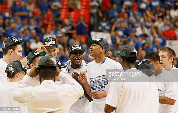 The Kentucky Wildcats celebrate defeating the Baylor Bears 82 to 70 during the 2012 NCAA Men's Basketball South Regional Final at the Georgia Dome on...