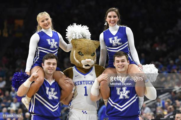 The Kentucky Wildcats cheerleaders and mascot perform on the floor during the First Round of the NCAA Basketball Tournament against the Abilene...