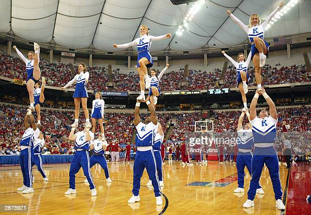 The Kentucky Wildcats cheerleaders perform during the game against the Indiana Hoosiers on December 20 2003 at the RCA Dome in Indianapolis Indiana...