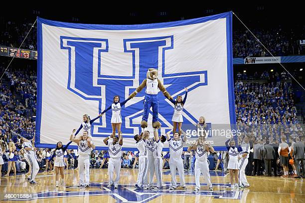 The Kentucky Wildcats cheerleaders perform during the game against the Texas Longhorns at Rupp Arena on December 5 2014 in Lexington Kentucky