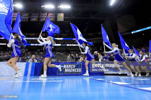 The Kentucky Wildcats cheerleaders take the court during the first round of the 2019 NCAA Men's Basketball Tournament at Jacksonville Veterans...