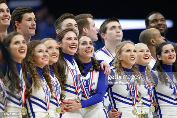 The Kentucky Wildcats cheerleading team celebrate as they are honored during a timeout for winning their 23rd National Championship at Rupp Arena on...