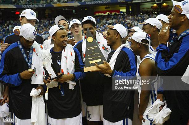 The Kentucky Wildcats claim the SEC Championship trophy after defeating the Florida Gators 8973 during the SEC Championship Men's Basketball...