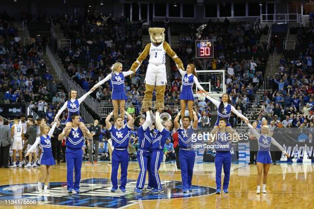 The Kentucky Wildcats mascot and cheerleaders form a large pyramid during a timeout in the second half of an NCAA Midwest Regional Sweet Sixteen game...