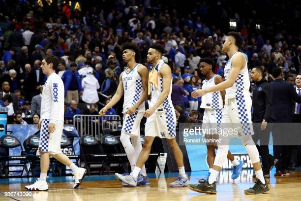 The Kentucky Wildcats walk off the court after being defeated by the Kansas State Wildcats during the 2018 NCAA Men's Basketball Tournament South...