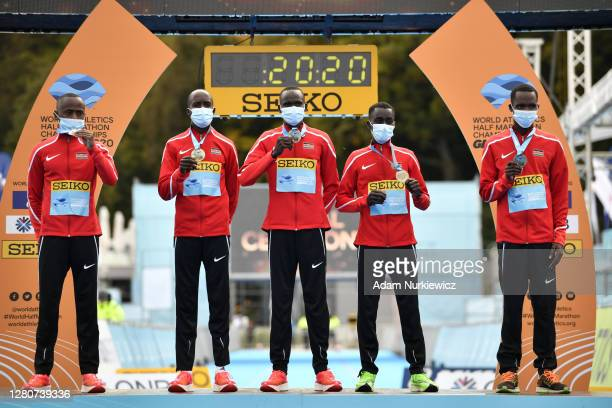 The Kenya team celebrate on the podium after coming first in the team standings in the Men's Final Race during the World Athletics Half Marathon...
