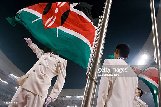 The Kenyan flag is unfurled during gold medal ceremonies for the women's 800 meters at the National Stadium on Monday August 18 in the Games of the...