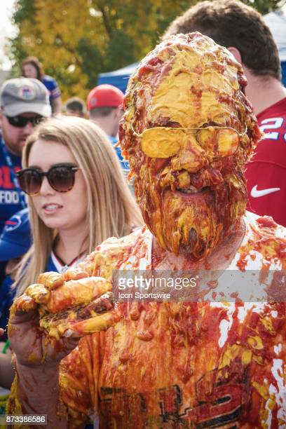 The ketchup and mustard shower while tailgating at the Hammer's Lot at the Pinto Ron tailgate party before the Buffalo Bills faced the Tampa Bay...