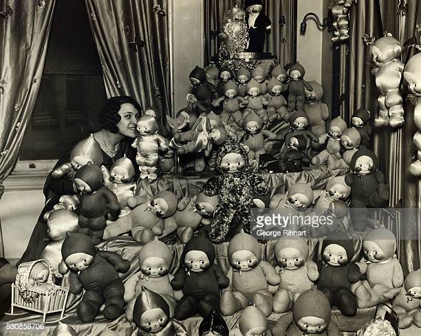 The Kewpie 1930 model an ocean of them being called to order by Miss Ursula Seiz at the New York Toy Fair which is being held at the Breslin Imperial...
