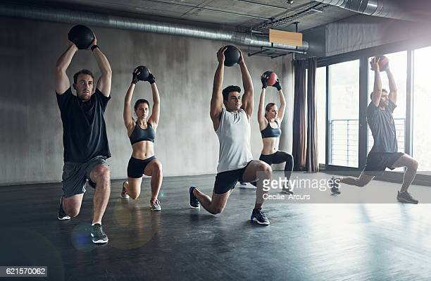 the key to fitness is regularity - medicine ball stock pictures, royalty-free photos & images