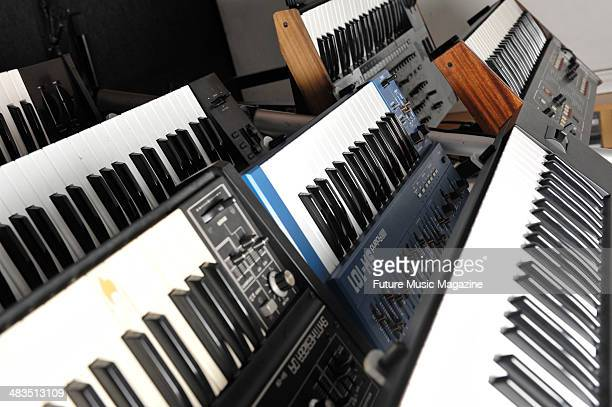 The keyboard and synthesiser collection of Simon Mills from British electronica band Bent Models include a Sequential Circuits SixTrak a Roland SH101...