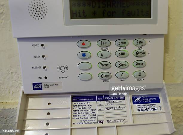 The keypad to an ADT home security alarm system is seen in a home on February 16 2016 in Miami Florida It was announced today that home security firm...