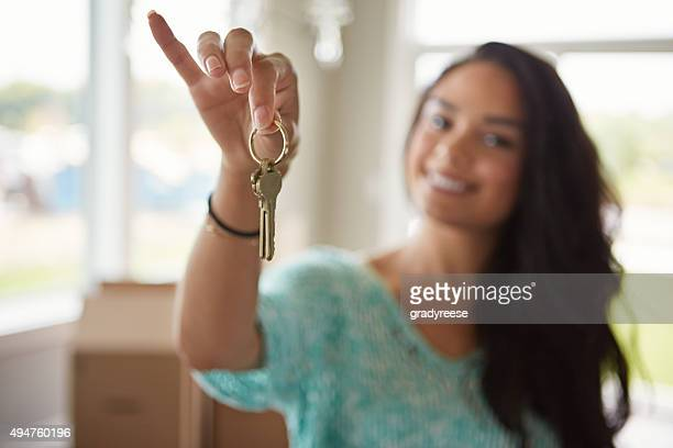 the keys to her new home - house key stock photos and pictures