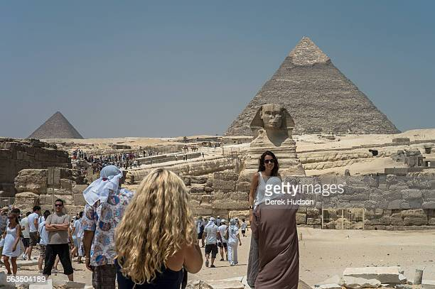 The Khafre pyramid looms over the sphinx and the second largest pyramid of the three on this site where tourists pose for pictures in front of the...