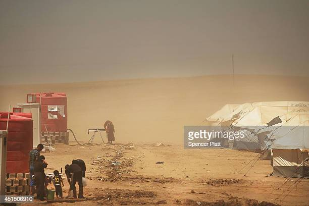 The Khazair displacement camp for those caughtup in the fighting in and around the city of Mosul is viewed on June 30 2014 in Khazair Iraq Khazair is...
