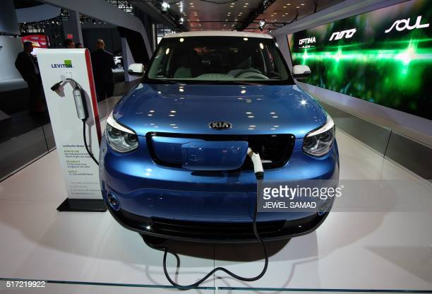 The Kia Soul EV is seen being charged during the New York International Auto Show on March 24 2016 / AFP / Jewel SAMAD