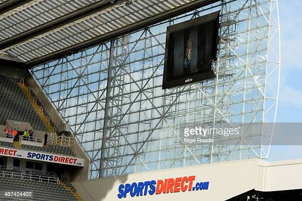 The kickoff is delayed as part of the new big screen comes loose in high winds prior to kickoff during the Barclays Premier League match between...