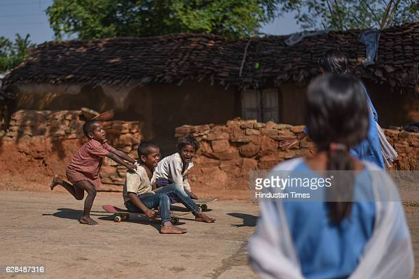 The kids are so attached to their skateboards that even ride on whatever level roads they can find in the village on October 26 2016 in Janwaar India...