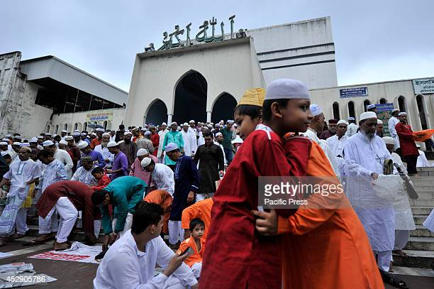 The kids embrace each other after the prayer in the National Mosque Baitul Mukarram in Dhaka After the month long fasting and prayer they show their...