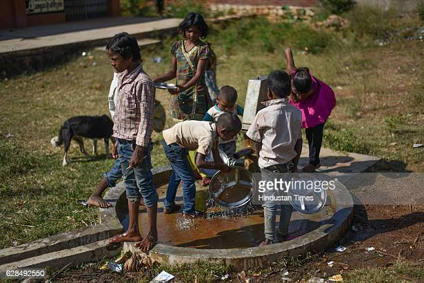The kids washing their plates after having midday meal served in the school on October 26 2016 in Janwaar India Thanks to a German community activist...